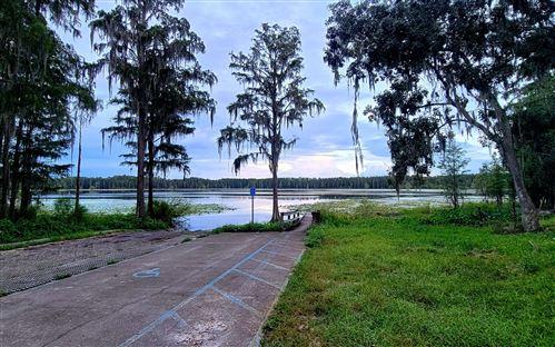 Photo of TBD SE KOON LAKE RD, Mayo, FL 32066 (MLS # 112930)