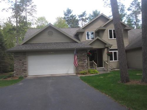 Photo of 9782 NORWAY LN, Woodruff, WI 54568 (MLS # 186378)