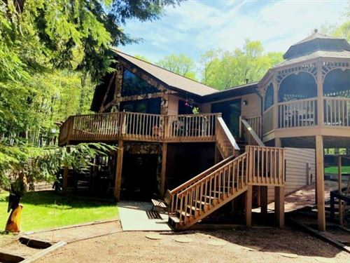 Photo of 7215 BIG LAKE RD, Land O Lakes, WI 54540 (MLS # 186391)