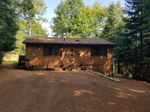 Photo of 8279 BRACEY LN, Lake Tomahawk, WI 54529 (MLS # 187415)