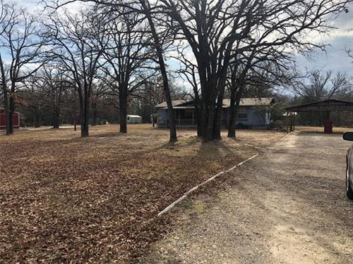 Photo of 506 Ole Wagon Road, Quinlan, TX 75474 (MLS # 14250105)