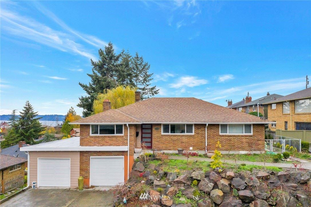 Photo of 8711 40th Avenue SW, Seattle, WA 98136 (MLS # 1684038)