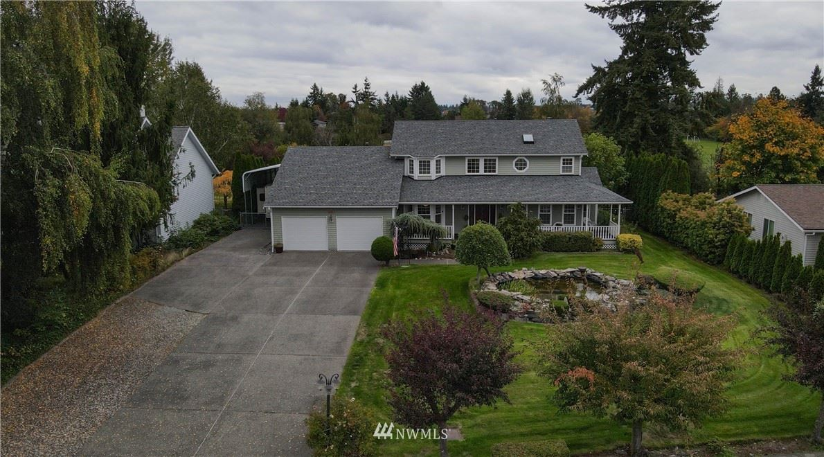 Photo of 4021 Blossom Drive NE, Tacoma, WA 98422 (MLS # 1856112)