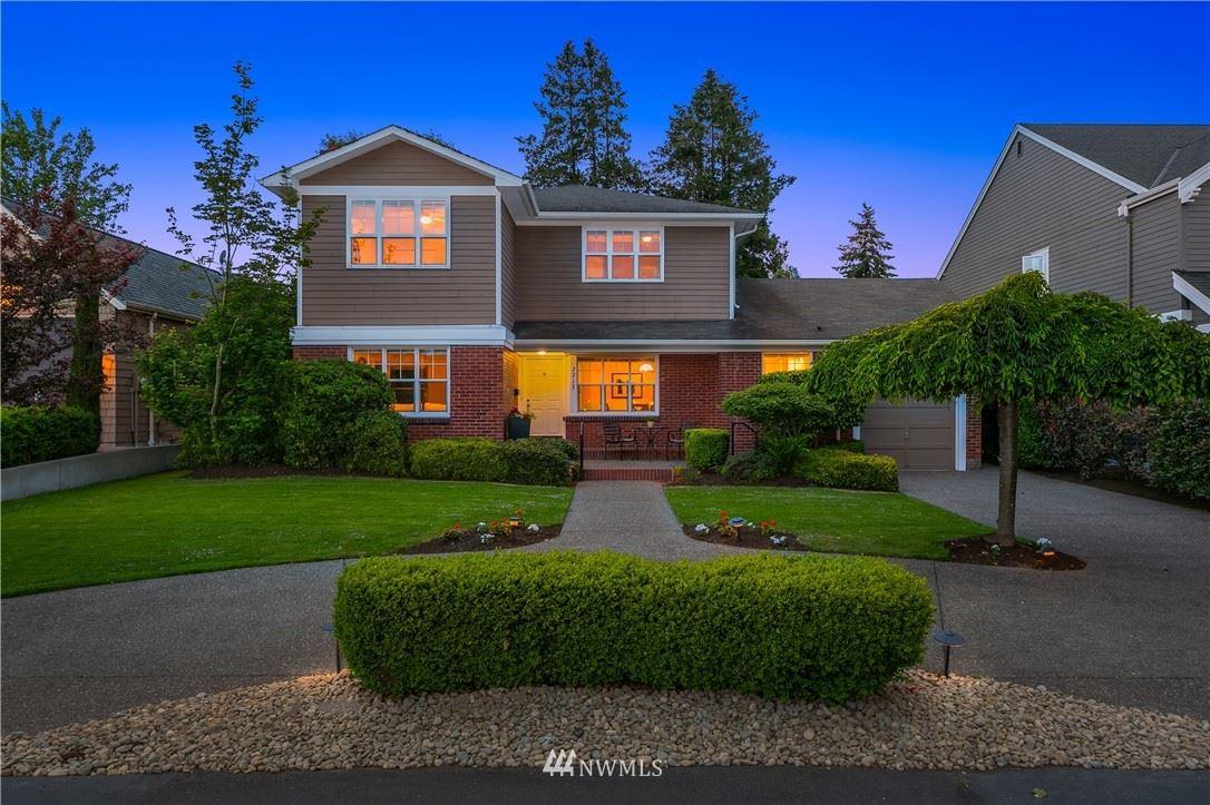 Photo of 7713 Ridge Drive NE, Seattle, WA 98115 (MLS # 1775212)