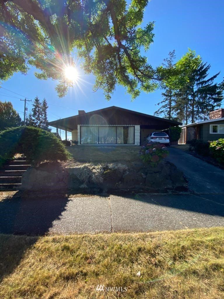 Photo of 7153 35th Avenue SW, Seattle, WA 98126 (MLS # 1673232)