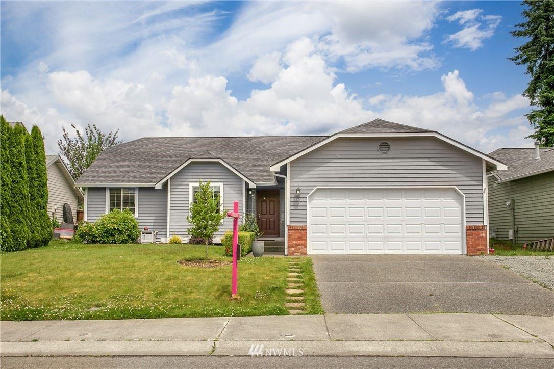 Photo of 11630 SE 219th Place, Kent, WA 98031 (MLS # 1792255)