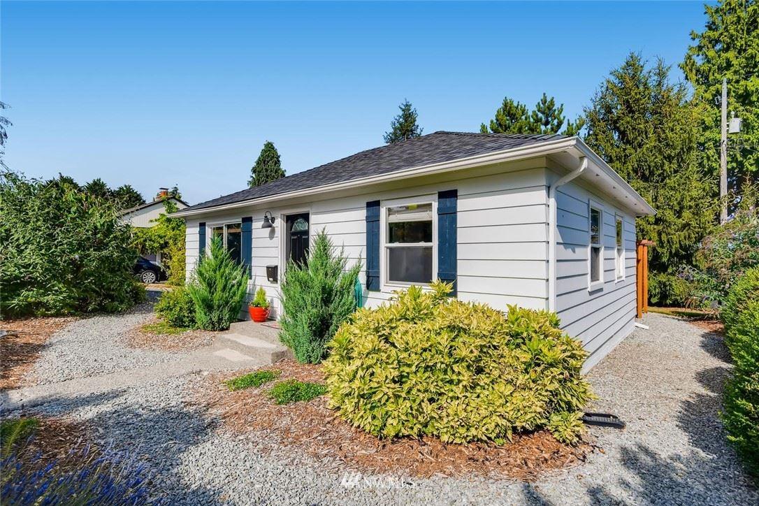 Photo of 9722 35th Avenue SW, Seattle, WA 98126 (MLS # 1642375)