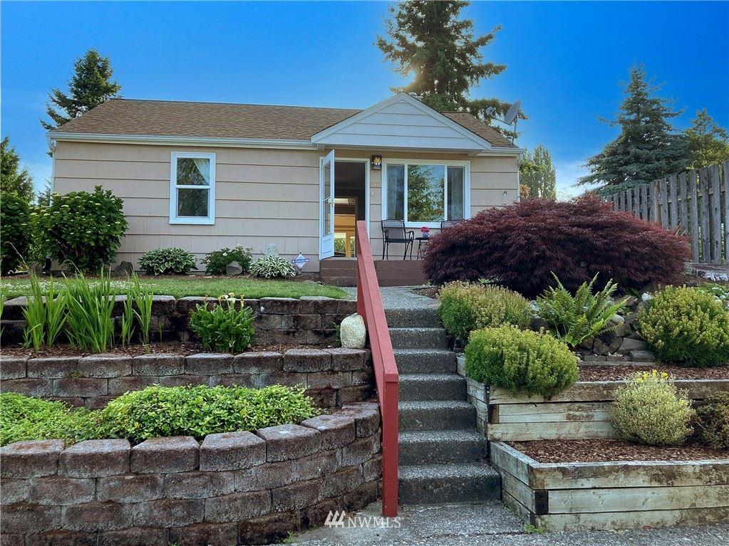 Photo of 8111 27th Avenue SW, Seattle, WA 98126 (MLS # 1792381)