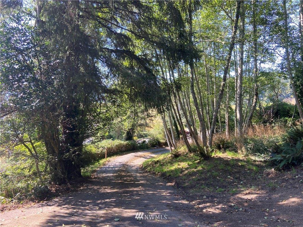 Photo of 171 NW Robert Gray Drive, Ilwaco, WA 98624 (MLS # 1830432)
