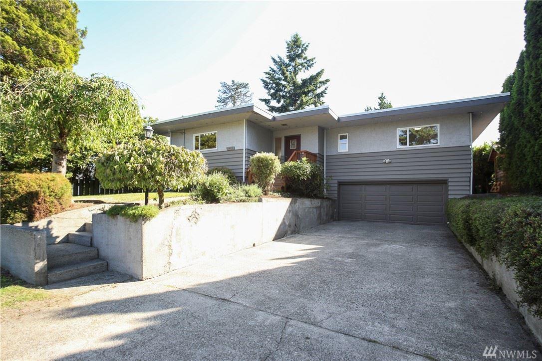 Photo of 11415 37th Avenue SW, Seattle, WA 98146 (MLS # 1602491)