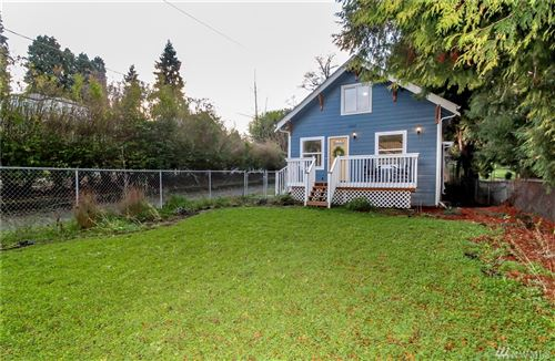 Photo of 12217 10th Ave S, Burien, WA 98168 (MLS # 1547528)