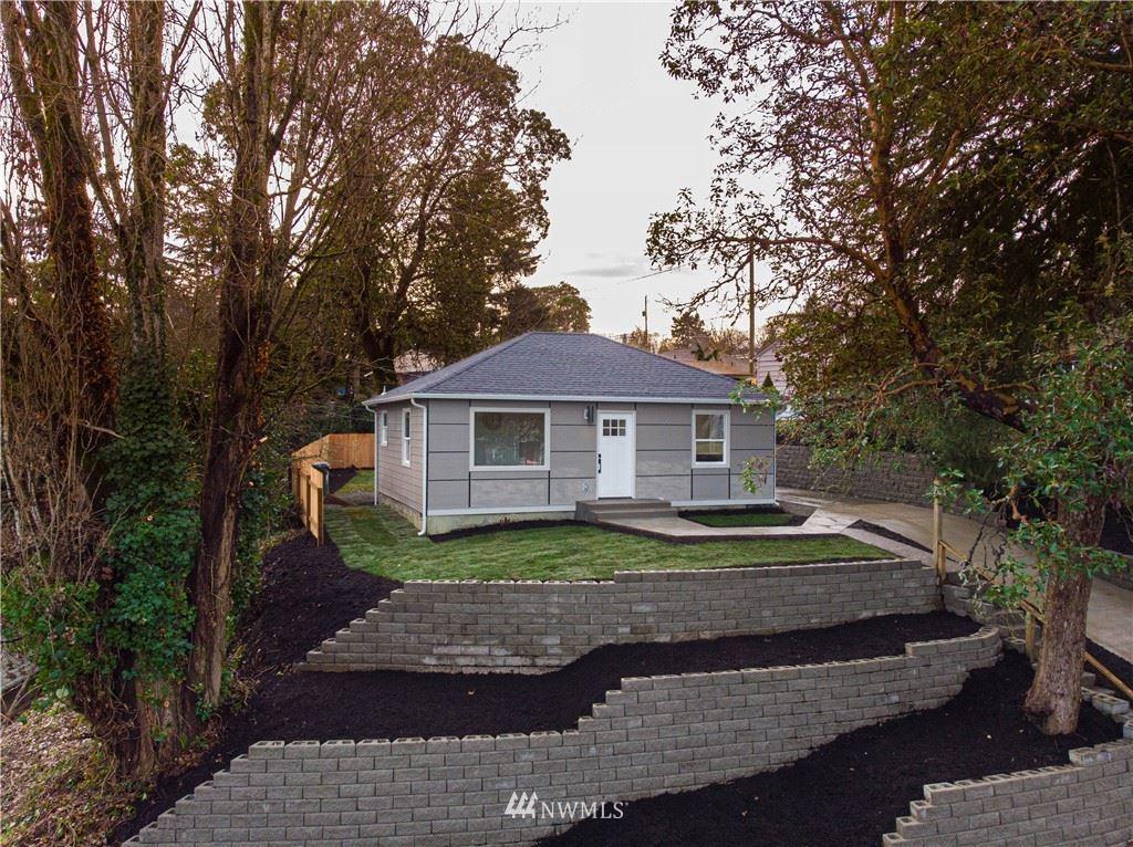 Photo of 3115 SW 97th Street, Seattle, WA 98126 (MLS # 1715597)