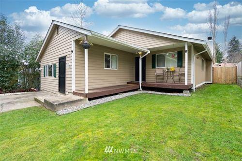 Photo of 613 E 51st Street, Tacoma, WA 98404 (MLS # 1718634)