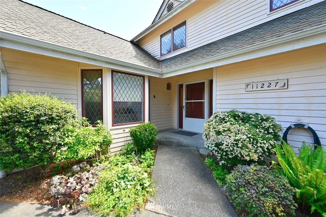 Photo of 11227 Goodwin Way NE, Seattle, WA 98125 (MLS # 1776649)