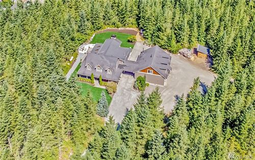 Photo of 30106 SE Retreat Kanaskat Rd, Ravensdale, WA 98051 (MLS # 1640689)