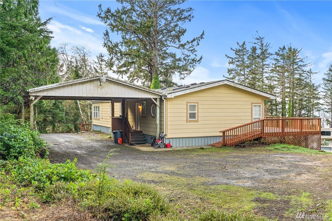 Photo of 20 Rhodesia Beach Rd, South Bend, WA 98586 (MLS # 1550706)