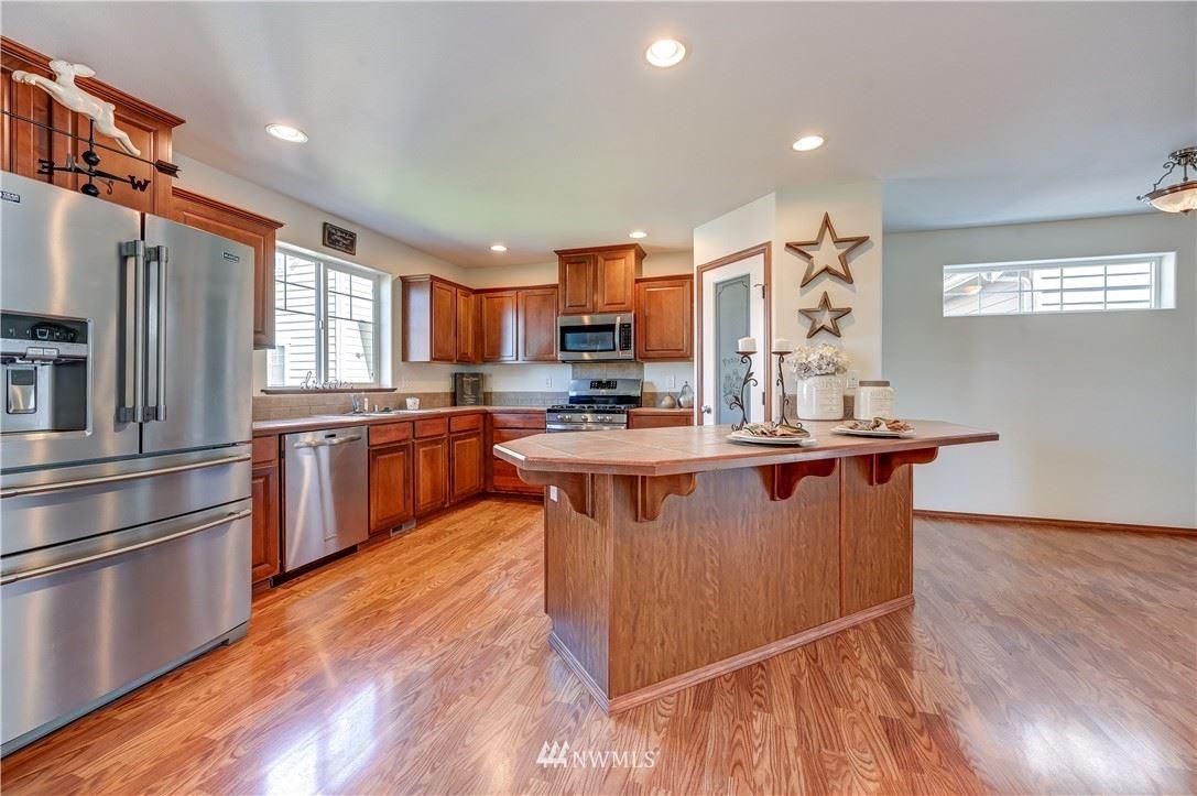 Photo of 8410 42nd Drive NE, Marysville, WA 98270 (MLS # 1789778)