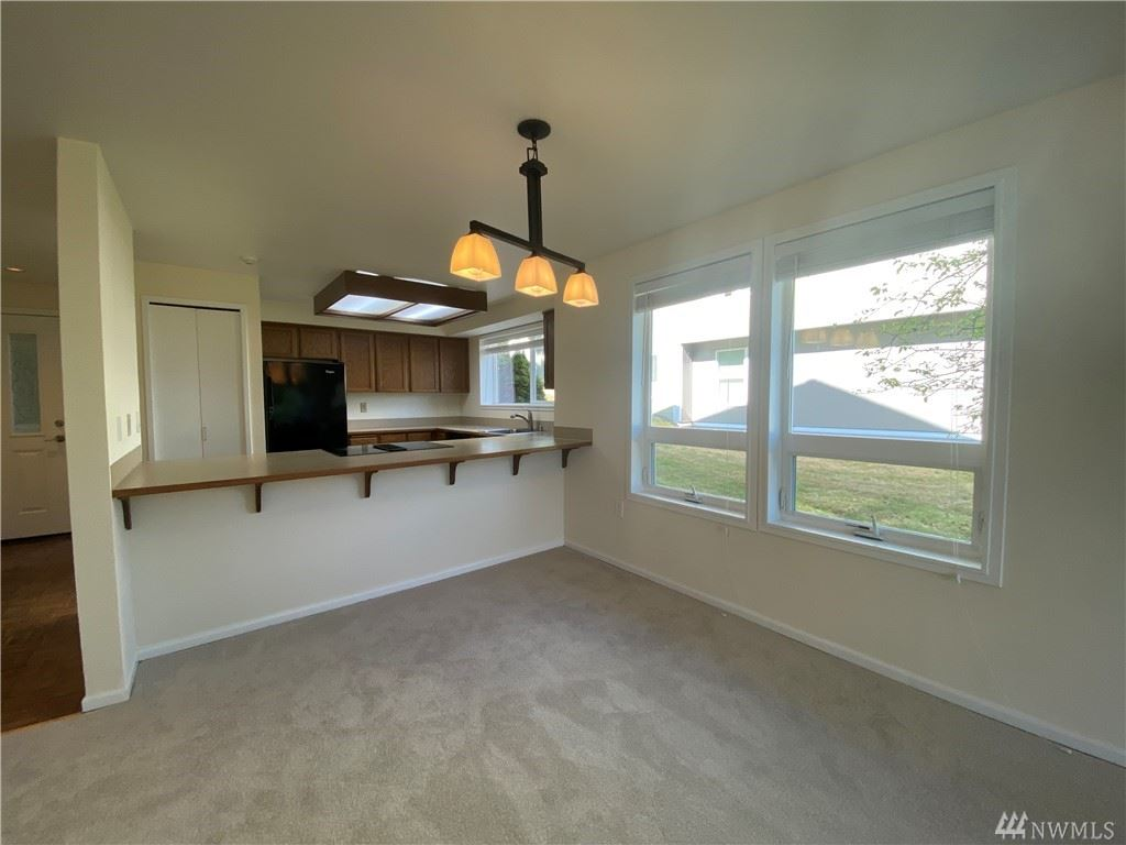 Photo of 15710 NE 70th Ct #15710, Redmond, WA 98052 (MLS # 1630813)