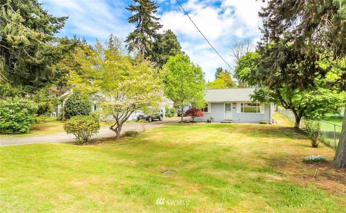 Photo of 12460 10th Avenue S, Seattle, WA 98168 (MLS # 1776834)
