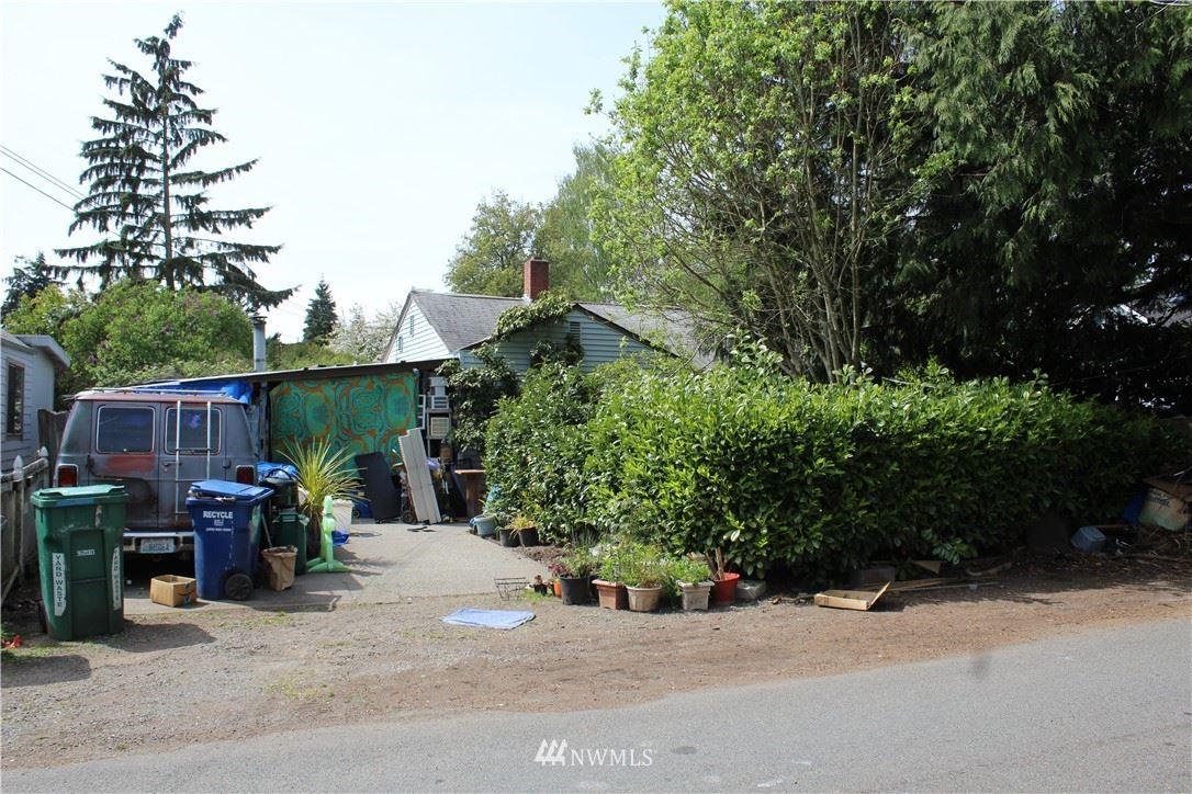 Photo of 8751 12th Avenue NW, Seattle, WA 98117 (MLS # 1764903)