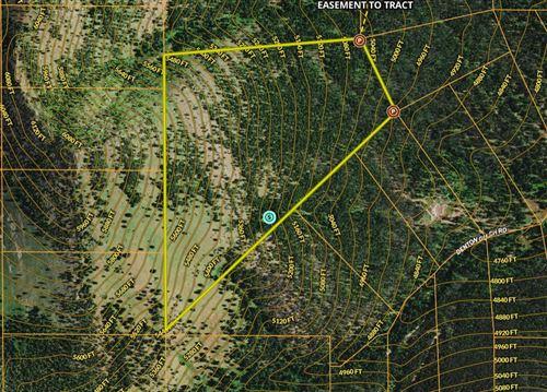 Photo of Nhn Little Wolf Creek Road, Wolf Creek, MT 59648 (MLS # 22015022)