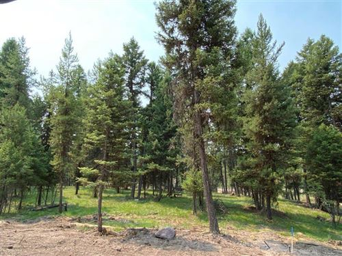 Photo of 304 Seclusion Point, Seeley Lake, MT 59868 (MLS # 22112035)