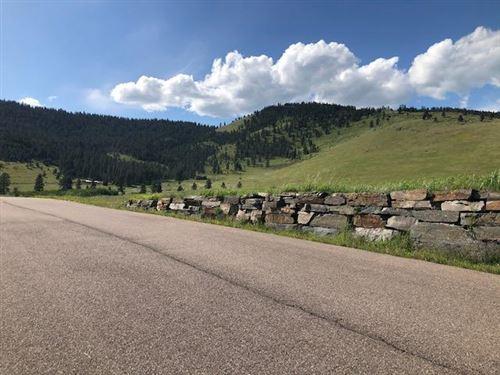 Photo of 33226 Deer Park Road, Polson, MT 59860 (MLS # 22008070)