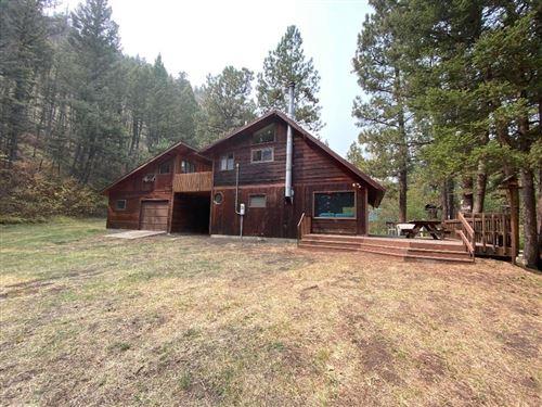 Photo of 3601 Little Wolf Creek Road, Wolf Creek, MT 59648 (MLS # 22015083)