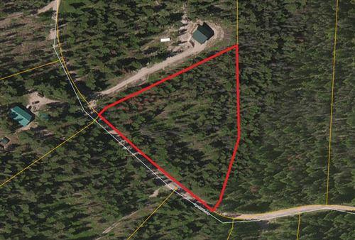 Photo of 256 Pyramid Loop, Seeley Lake, MT 59868 (MLS # 21918128)