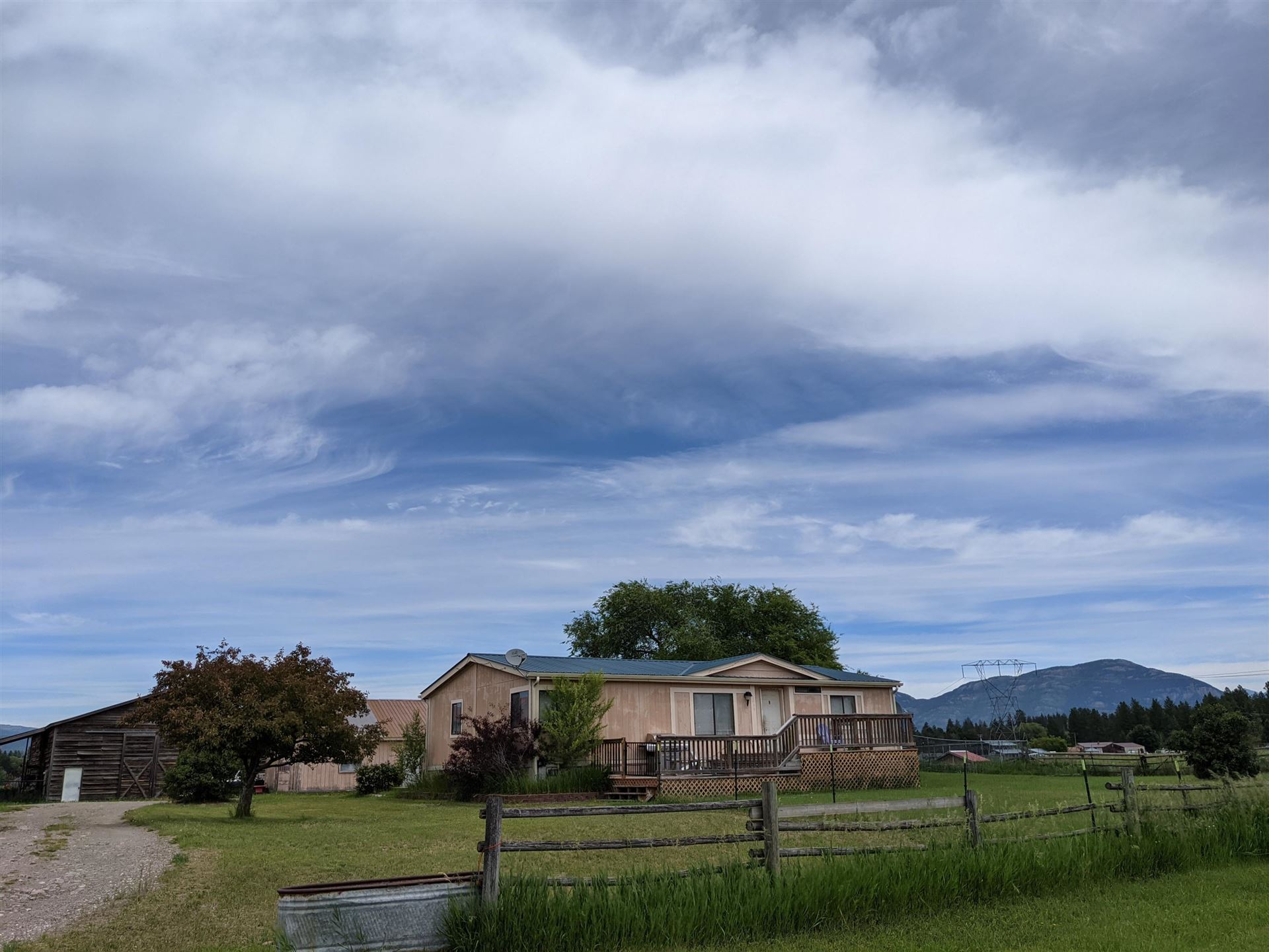 Photo of 3599 Sunny Lane, Columbia Falls, MT 59912 (MLS # 22102358)
