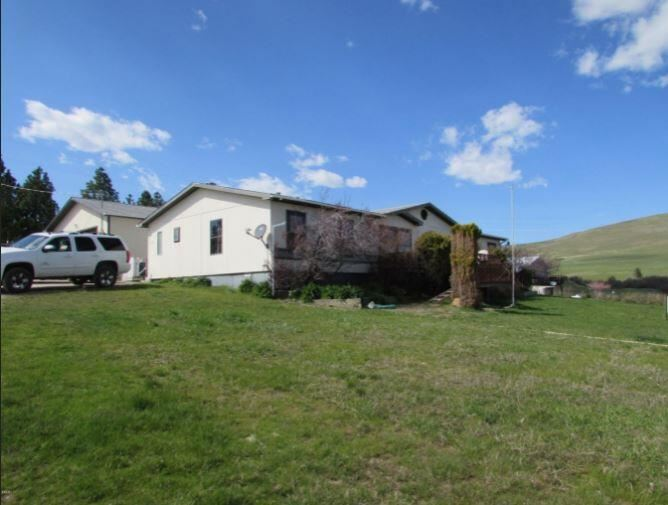 Photo of 614 3rd Avenue North, Hot Springs, MT 59845 (MLS # 22116428)