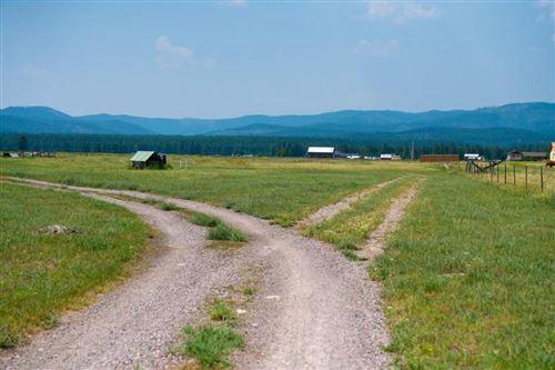 Photo of 3840 Farm To Market Road, Kalispell, MT 59901 (MLS # 22111457)