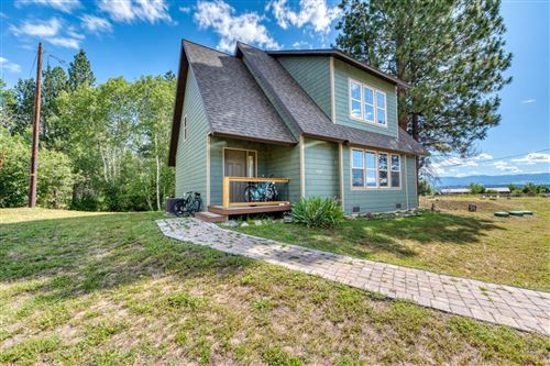 Photo of 406 Wolfville Lane, Florence, MT 59833 (MLS # 22015479)