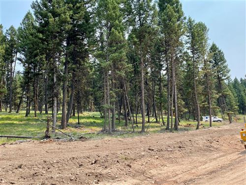 Photo of 349 Seclusion Point, Seeley Lake, MT 59868 (MLS # 22111696)