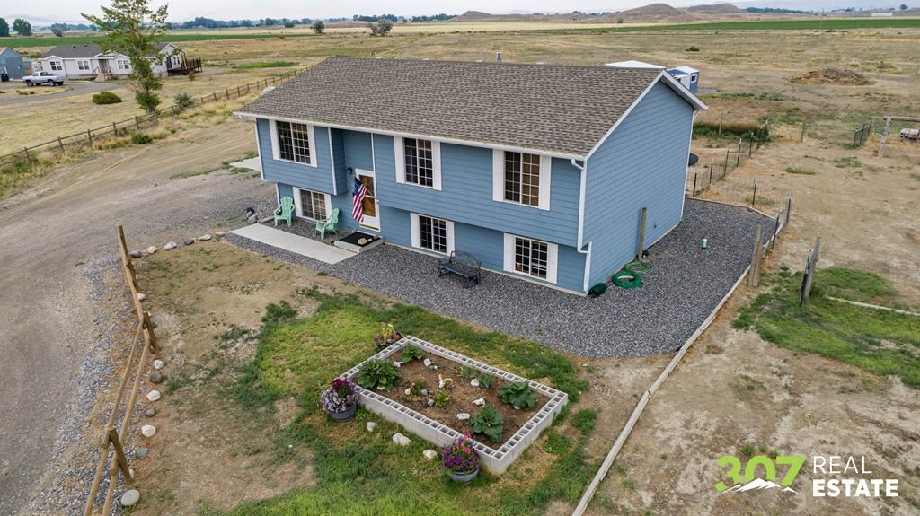 Photo of 830 Running Horse Rd, Powell, WY 82435 (MLS # 10017139)