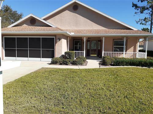 Photo of 11230 SW 73rd Circle, Ocala, FL 34476 (MLS # 567034)