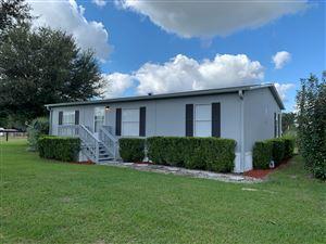 Photo of 265 SE HWY 42, Summerfield, FL 34491 (MLS # 566042)