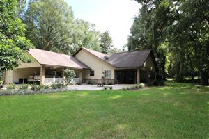 Photo of 680 NW 63rd Place, Ocala, FL 34475 (MLS # 563371)