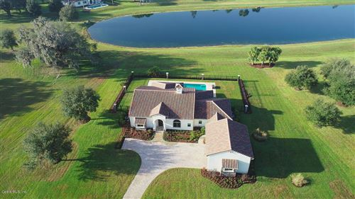 Photo of 12329 SW 140th Loop, Dunnellon, FL 34432 (MLS # 567637)