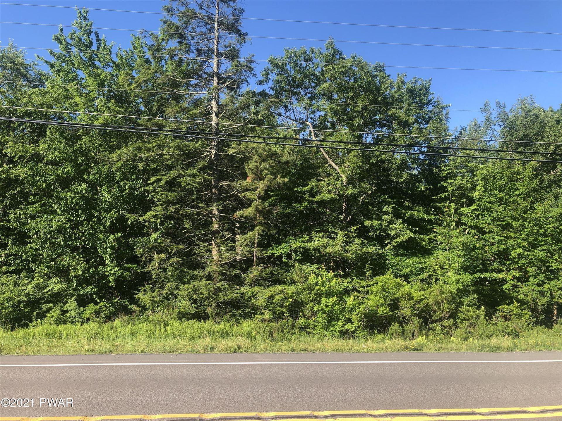 Photo of 64 White Birch Ln, Hawley, PA 18428 (MLS # 21-2205)