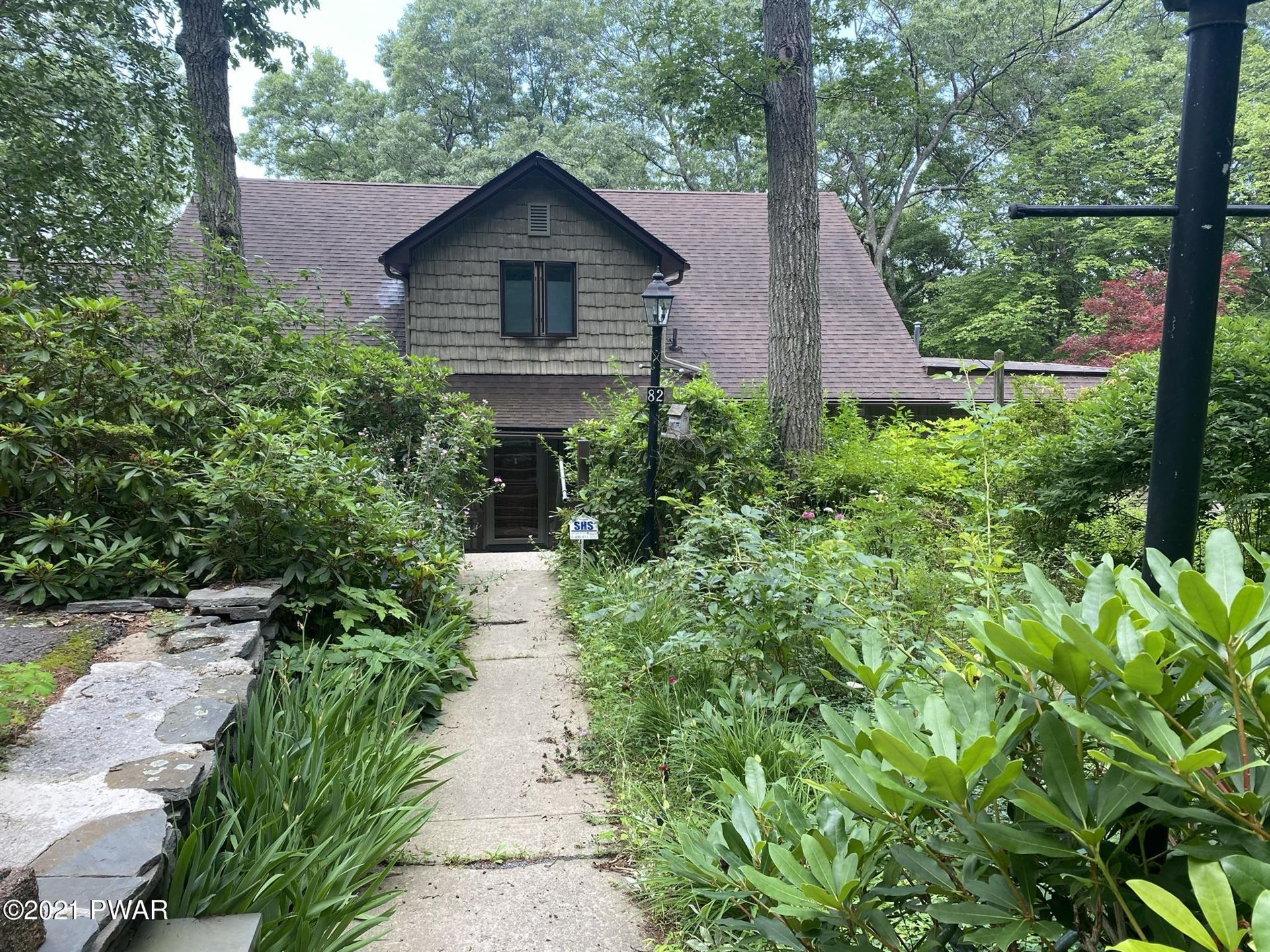 Photo of 82 Paupack Point Rd, Hawley, PA 18428 (MLS # 21-2778)