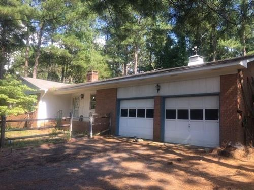 Photo of 8 Shadow Drive, Whispering Pines, NC 28327 (MLS # 201138)