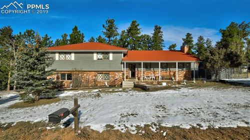 Photo of 400 Sunnywood Lane, Woodland Park, CO 80863 (MLS # 2042559)