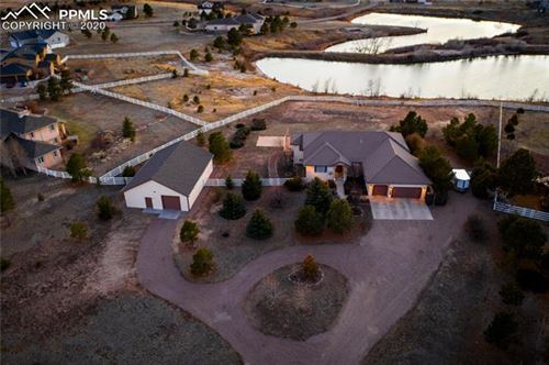 Photo of 7220 Silver Ponds Heights, Colorado Springs, CO 80908 (MLS # 9908846)
