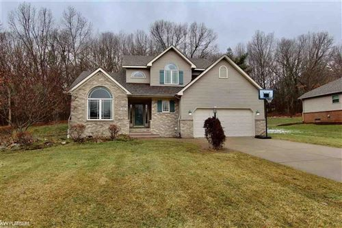 Photo of 571 SUNRISE DR, CLARKSTON, MI 48348 (MLS # 58050003008)