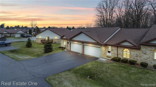 Photo of 7100 BLUEWATER Drive, Springfield Township, MI 48348 (MLS # 2200022051)