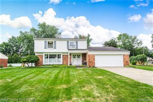 Photo of 8828 CARRIAGE HILL Drive, Shelby Township, MI 48317 (MLS # 219084086)
