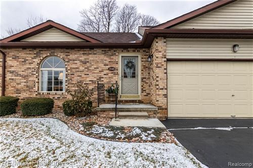 Photo of 7148 BLUEWATER Drive #13, Springfield Township, MI 48348 (MLS # 219124086)