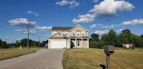 Photo of 1047 Huber Ponds Dr., Eaton Township, MI 48813 (MLS # 630000247203)