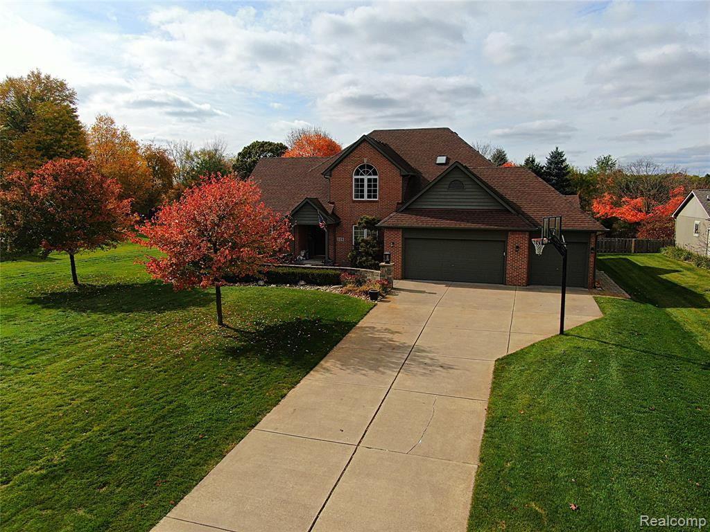 Photo of 529 MAPLEWOOD Lane, Wixom, MI 48393 (MLS # 2200087301)